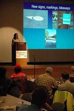 Mia Birk presenting